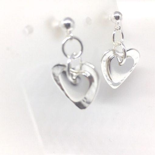 Silver double heart stud earrings. Handcrafted silver heart earrings