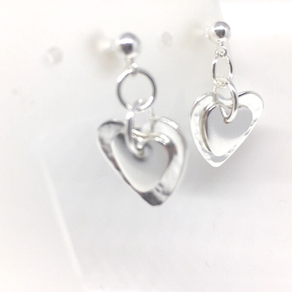 Silver double heart stud earrings. Handcrafted silver heart earrings