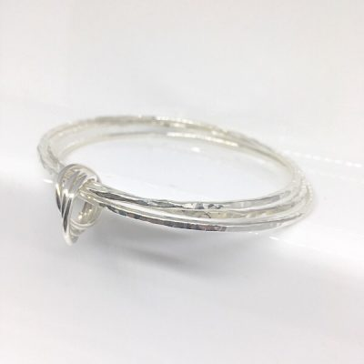 Oria silver triple stacking bangles with russian ring charm. A silver stacking bracelet set