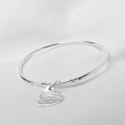 Kyla silver bangle. Hammered silver bangle with heart charm. Stacking silver bangle