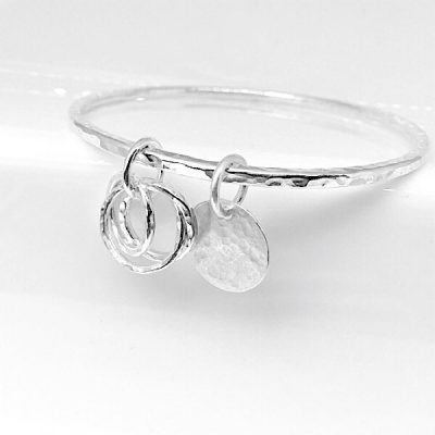 Kata hammered silver bangle . Russian ring and disc charms and disc charm for personalisation