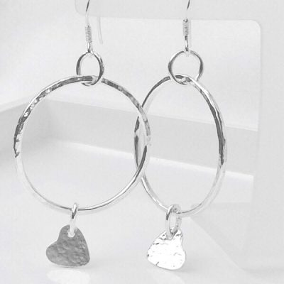 Silver hoop and dangly heart earrings. Hoop earrings with a dangly heart charm.