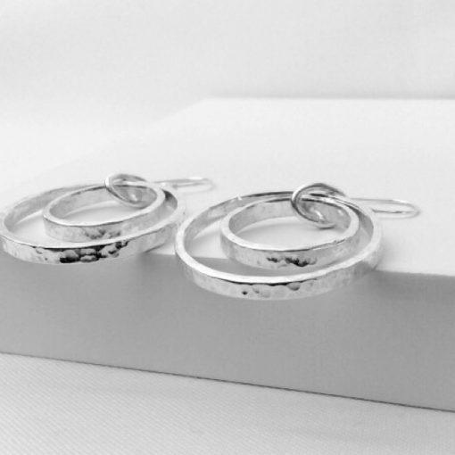 Contemporary silver hoop earrings