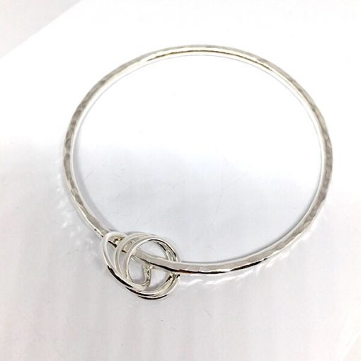 Anna liver bangle with russian ring charm. Handmade silver bangle with charm
