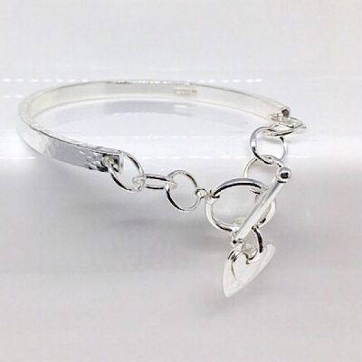 Elin silver bangle bracelet. Silver bracelet with heart charm and T bar clasp