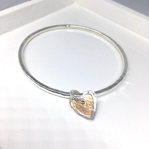Textured silver bangle and rose gold charm