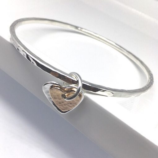 Silver stacking bangle with heart charm