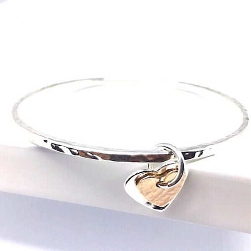 Silver bangle with rose gold filled heart charm. Stacking silver bangle bracelet