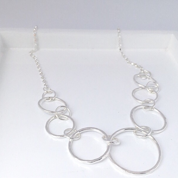Silver hammered circle and chain link necklace. Contemporary silver hammered necklace available in two sizes