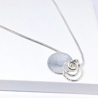 Silver disc and ring pendant . Textured domed pendant and chain