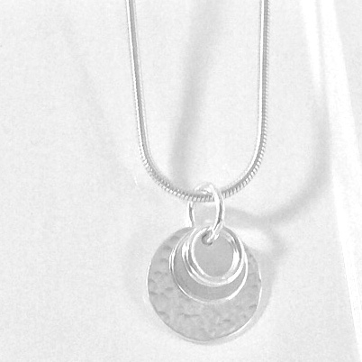 Silver hammered disc pendant