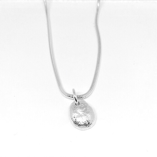Solid silver pebble pendant