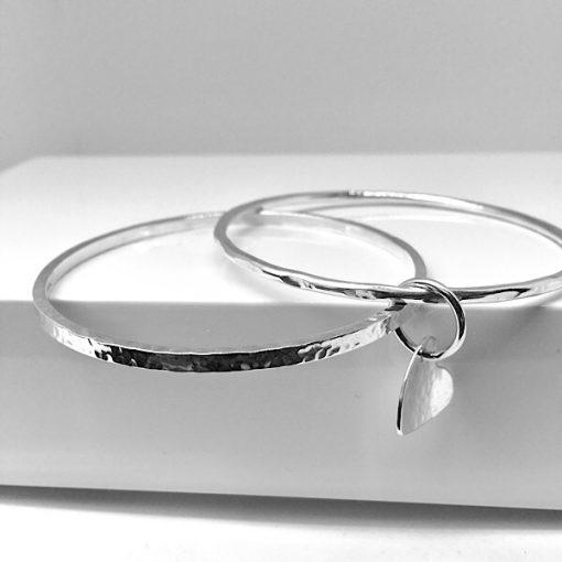 Silver stacking hammered bangles