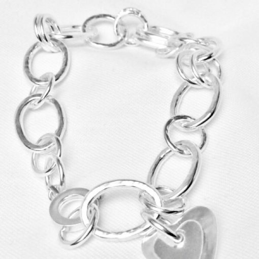 Silver bracelet with heart charm. Hammered and smooth polished links