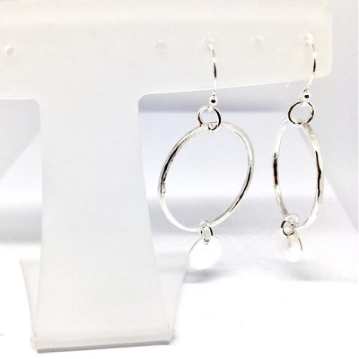 Silver hoop earrings with mini disc charms