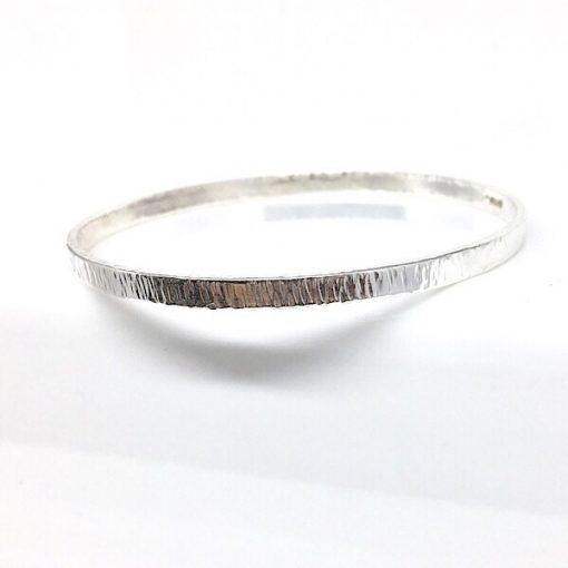 Solid silver textured bangle bracelet. Silver bangle with bark effect hammered texture