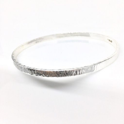 Silver bangle with bark effect texture