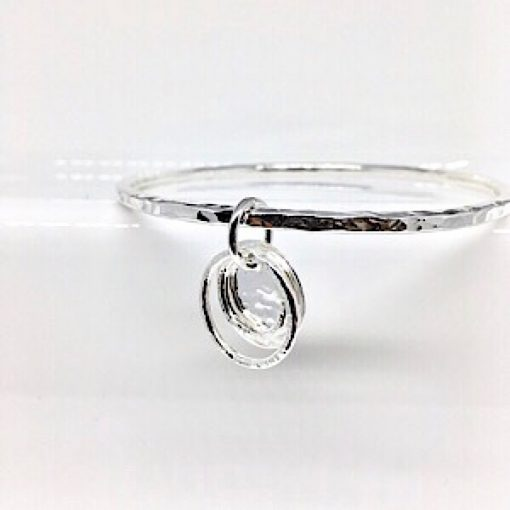 Silver stacking bangle with disc and ring charm