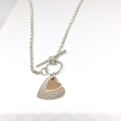 Silver and rose gold heart pendant with chain
