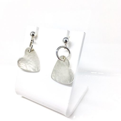 Silver dangly textured heart earrings