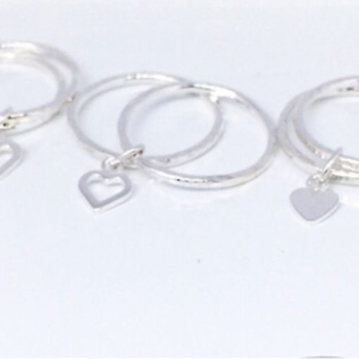 Silver double stacking rings joined with a tiny heart charm