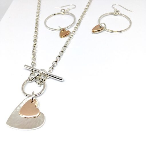 Silver and rose gold hearts collection. Silver pendant and hoop earrings