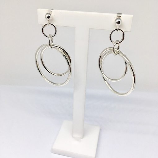 Silver dangly hammered hoops