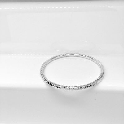 Solid silver textured bangle